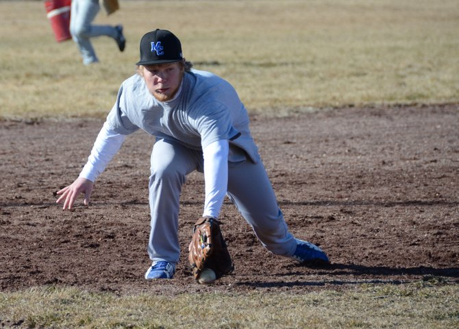 Senior Josh Pritchard fields a ground ball at third base during Moffat County practice this week. Pritchard is one of nine seniors on the team, which has started the season 3-4.