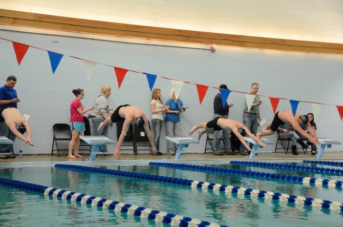 Dean Wagner, Bryce Tuttle, Jesse Kurz and Chris Kling start off the blocks at the Moffat County home swimming meet last weekend. The Bulldogs will return from spring break with five more chances to qualify for the state meet May 17 and 18.