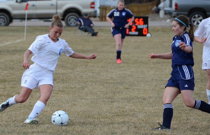 Moffat County junior Jazmine Swindler looks to cross the ball during a girls soccer game vs. Vail Christian. The Bulldogs are confident they can be a contender in Class 3A this season.