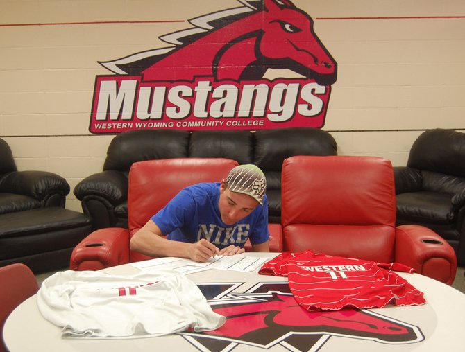 Moffat County senior Bryant Cox signs his letter of intent to play at Western Wyoming Community College. The Bulldog's high school soccer career is over, but he will start playing again in August for the Mustangs in Rock Springs, Wyo.
