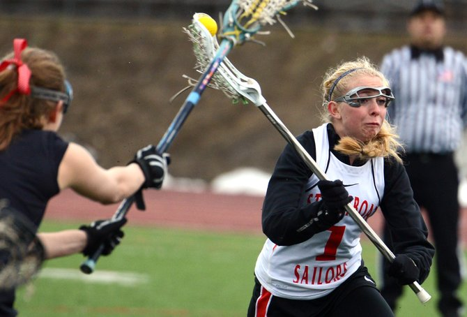 Steamboat's Dani Flax fires a shot Saturday as the girls lacrosse team beat Eagle Valley, 13-4.