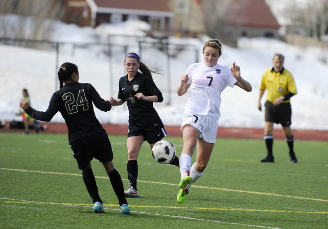 Steamboat Springs High School junior Alice Holmquist goes for the ball during Saturday's game against Battle Mountain.