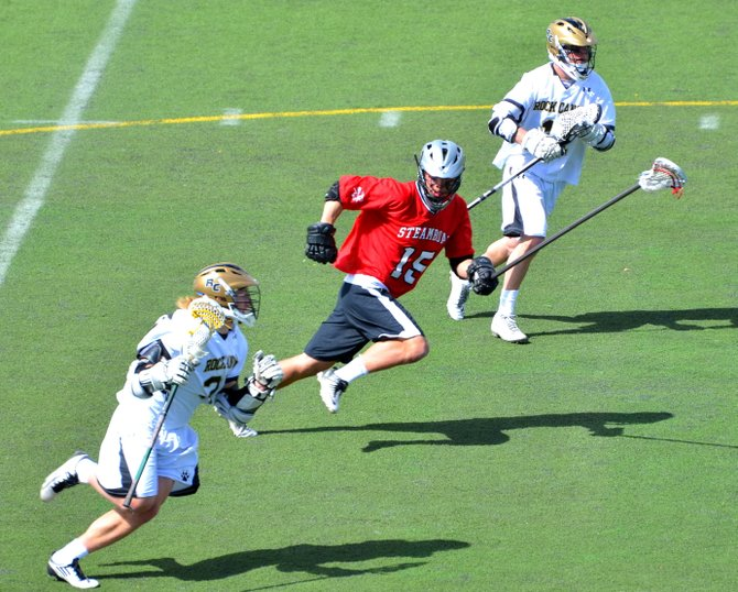 Michael Wong pursues a Rock Canyon player Saturday during the Steamboat Springs High School boys lacrosse game. The Sailors fell, 10-6.
