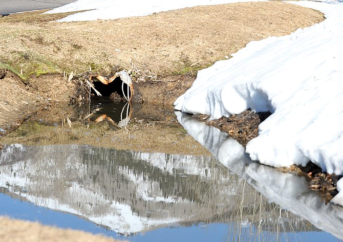 The snow-covered runs of Steamboat Ski Area are reflected in runoff near Walton Creek Road in Steamboat Springs. Officials in Steamboat Springs plan to enact Stage 2 water restrictions May 1.