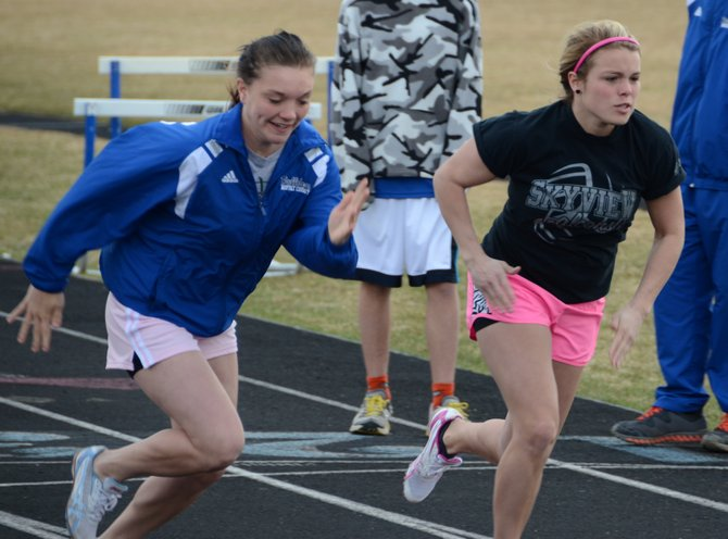 Kayla, left, and Cheianne Pinnt work through a sprinting drill Tuesday at the Moffat County High School track. The girls transferred to MCHS as the track season was starting and have been key members of the Bulldogs' sprinters this season.