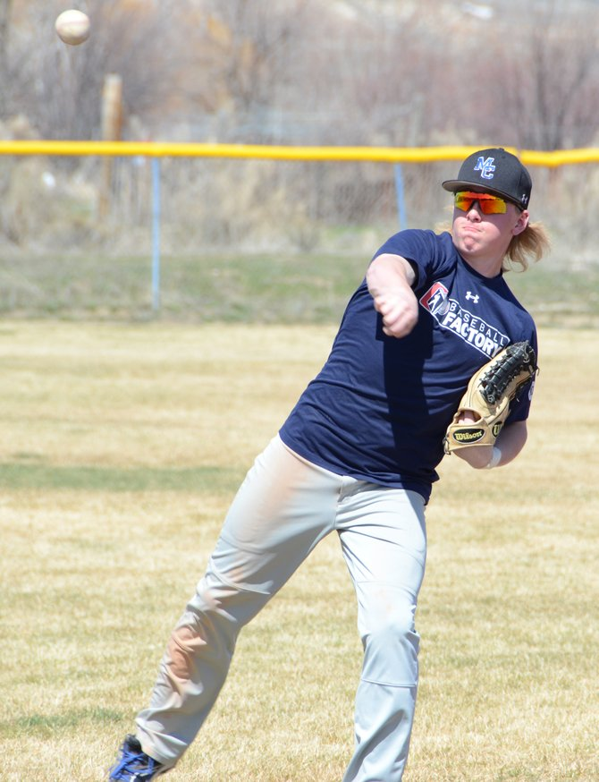 Bubba Ivers throws the ball at the beginning of baseball practice Thursday at the Craig Middle School fields. About 10 players have been meeting all week during spring break to keep working on their games.