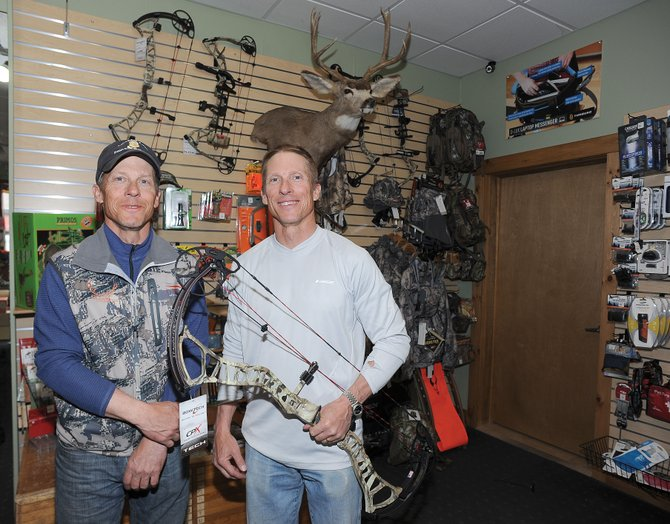 Brett Lee, right, who owns Straightline Sports with his brother Bruce, said they made the decision to stock archery hunting equipment before the passage of recent gun bills. That decision has only been confirmed by recent developments, he said.