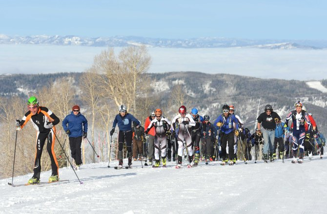 Racers take off from the starting line of the fifth-annual Cody's Challenge on Saturday as fog lays like a blanket over Steamboat Springs and the Yampa Valley. The event drew nearly 80 racers, many of whom were ski patrollers.