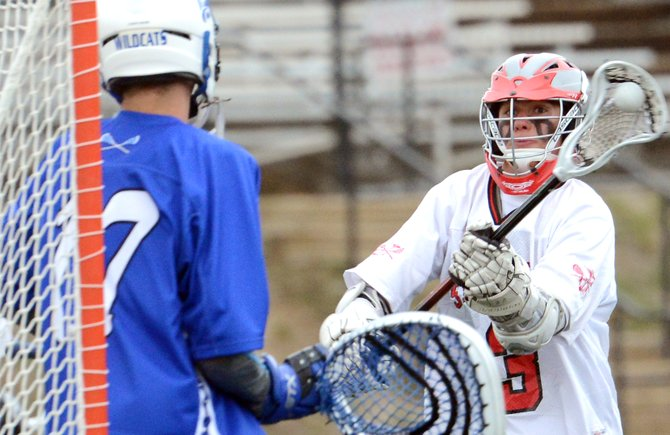Steamboat's Thomas Tarcha tosses a shot toward the net Monday as Steamboat beat Fruita, 12-1. He scored on the play, one of his three goals.
