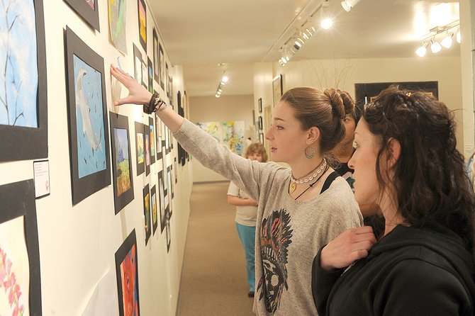 Steamboat Springs High School art student Sage Sullivan and mentor Missy Borden check out Sullivan's artwork at the Steamboat Springs Center for Visual Arts on Tuesday morning.
