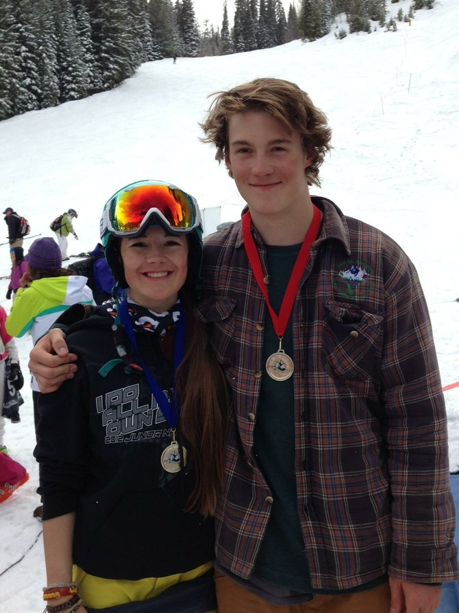 Jaelin, left, and Skyler Kauf take a break after finishing the moguls season during the weekend in Winter Park. Jaelin Kauf was third in single moguls and won the dual moguls event, and Skyler Kauf was second in dual moguls.