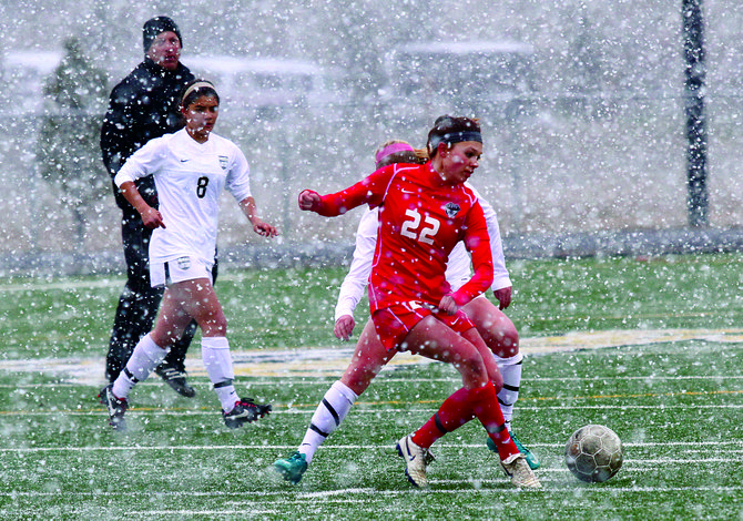 Steamboat Springs' Megan Stabile, right, clears the ball away from Battle Mountain's forwards during their snowy game Wednesday in Edwards. The game ended in a 2-2 draw.