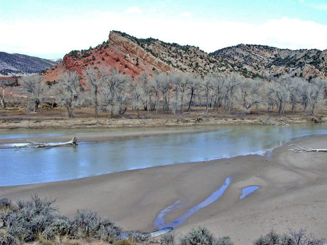 The Yampa River flows through Dinosaur National Monument at Deerlodge Park, the eastern most point of the monument in Moffat County. Congressional sequestration is forcing Dinosaur to trim about $170,000 from its operating budget this fiscal year, but monument attractions will not be affected. Plans to rehabilitate Deerlodge Park Road also will move ahead as planned.