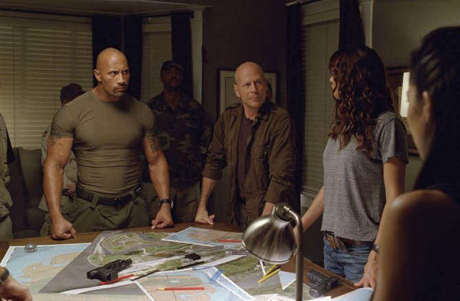 "Roadblock (Dwayne Johnson) and Gen. Joseph Colten (Bruce Willis) prepare their team to save the world in ""G.I. Joe: Retaliation."" The movie is a continuation of the series about a team of specially trained soldiers who battle the forces of the evil Cobra organization."