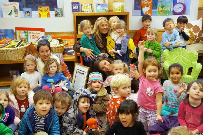 Steamboat Springs resident Nancy Spillane poses with students in the new library she helped to establish at Paddington Station Preschool. Spillane served as the school's interim director last year and has earned praise for helping the campus through turmoil.