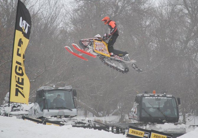 AJ Stoffle, 15, of Craig, gets air during the International Series of Champions Snocross race in Fargo, N.D., in March. Stoffle and other Craig riders finished up their snocross seasons recently, claiming several regional points championships.