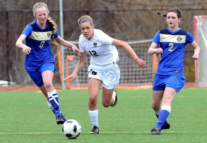 Natalie Bohlmann races a pair of Wheat Ridge defenders for a loose ball Saturday. The Sailors hung in the game in the first half but eventually lost, 1-0.