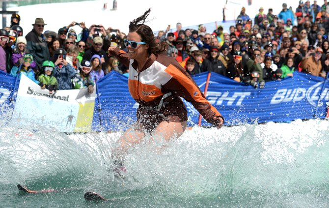 Kelsey McMillan sinks as she glides across the water Sunday at the Slash Down Pond Skim competition at Steamboat Ski Area. The competition helped mark Closing Day for the resort.