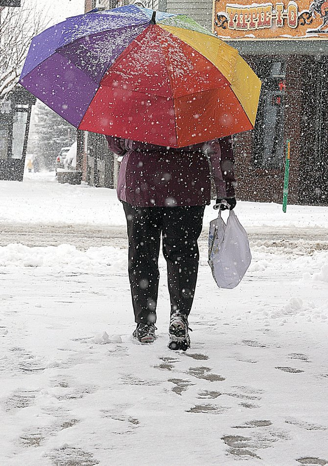 Steamboat Springs resident Mary Dobbin makes her way through the snow Monday on Lincoln Avenue.