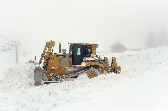 A Caterpillar D7 cuts a road near the Four Points Hut near the top of Mount Werner. Steamboat Ski Area closed Sunday, and crews already are busy working to clear snow and cut roads for the construction of a new 13,000-square-foot Four Points Lodge.