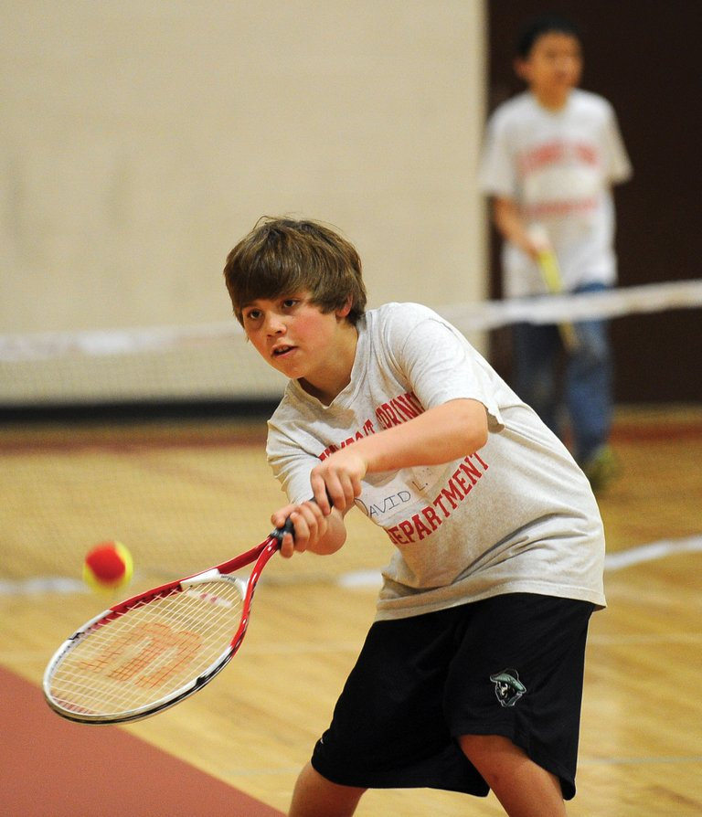 Steamboat Springs Middle School student David LaPointe plays tennis during physical education Wednesday morning. The class is part of the Tennis Center at Steamboat Springs' Junior Tennis Expansion Initiative.
