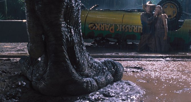 "Dr. Alan Grant (Sam Neill) protects Lex Murphy (Ariana Richards) as they are approached by the Tyrannosaurus rex in ""Jurassic Park."" The movie is a rerelease of the 1993 hit about a dinosaur theme park where everything goes wrong."