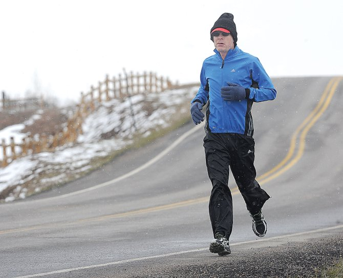 Paul Hughes braves the unpredictable spring weather in Steamboat Springs on Tuesday afternoon. Forecasts are calling for warmer temperatures by the weekend.