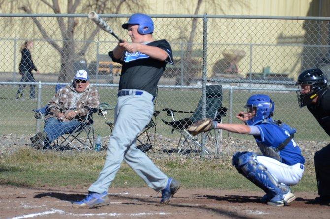 Colten Yoast puts a ball in play during the first of two games Wednesday at the Craig Middle School fields. Yoast had the game-tying RBI double in the first game as Moffat County split the doubleheader with Cedaredge.