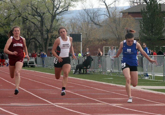 Kayla Pinnt leans for the finish line during her 100-meter dash at the Phil Wertman Invitational last Friday. Pinnt took first place and will look to do it again this Friday in Craig at the Clint Wells Invitational.