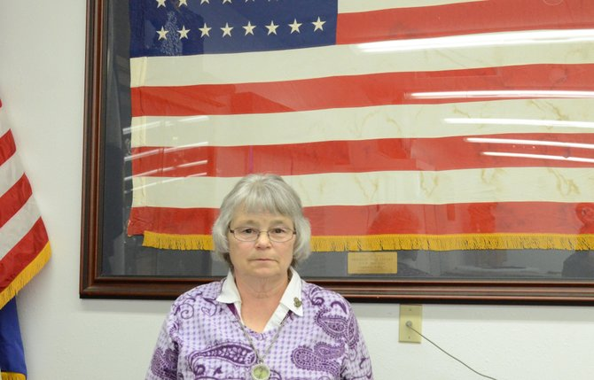 Mary Walters, of Craig, stands in front of the American flag at VFW Post 4265 in Craig. Walters, who serves as part of the Ladies Auxiliary in Craig, was honored with the VFW 2012-13 Salute to Service Award for her volunteer work with the organization.