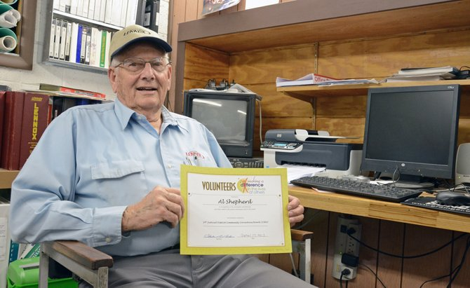Craig resident Al Shepherd, 81, poses in his office at Shepherd & Sons Heating and Air Conditioning, Inc. with a certificate recognizing his 29 years of volunteer service to the 14th Judicial Community Corrections Board. Shepherd is a lifelong volunteer who first began serving the community as a 9-year-old Cub Scout.