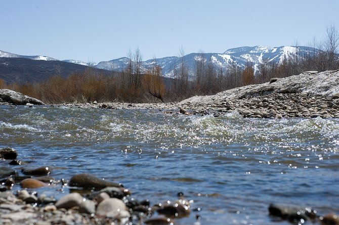 Low temperatures have preserved most of the snowpack in the mountains surrounding Steamboat Springs, resulting in near-record low flows in the Yampa River this spring. That's expected to change as temperatures continue to climb this weekend.