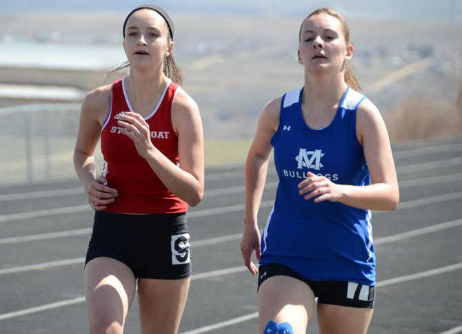 Moffat County's Aubrey Campbell, right, races Steamboat's Alex Tumminello in the girls 800 on Friday at the Clint Wells Invitational in Craig.