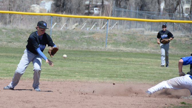 Moffat County shortstop Trevor Kroese fields a ball thrown by catcher Philip Chadwick on Saturday at Craig Middle School. MCHS lost its first game against Coal Ridge, 23-18, but rebounded in the second, winning 13-2.