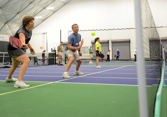 Laurie Buelow and Ric Ostrom play Sunday in a pickleball tournament at the Tennis Center at Steamboat Springs. The event drew about 30 players, helping signal the way the sport has caught on in town in the last year.