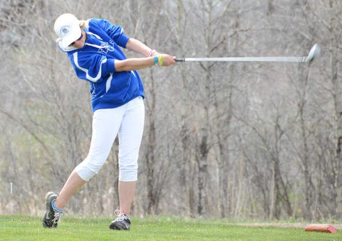 Shianna Dockins hits off the 17th tee at Yampa Valley Golf Course on Monday. Dockins and MCHS teammate Alex Bulla shot a 103 in the Bulldogs' home tournament.
