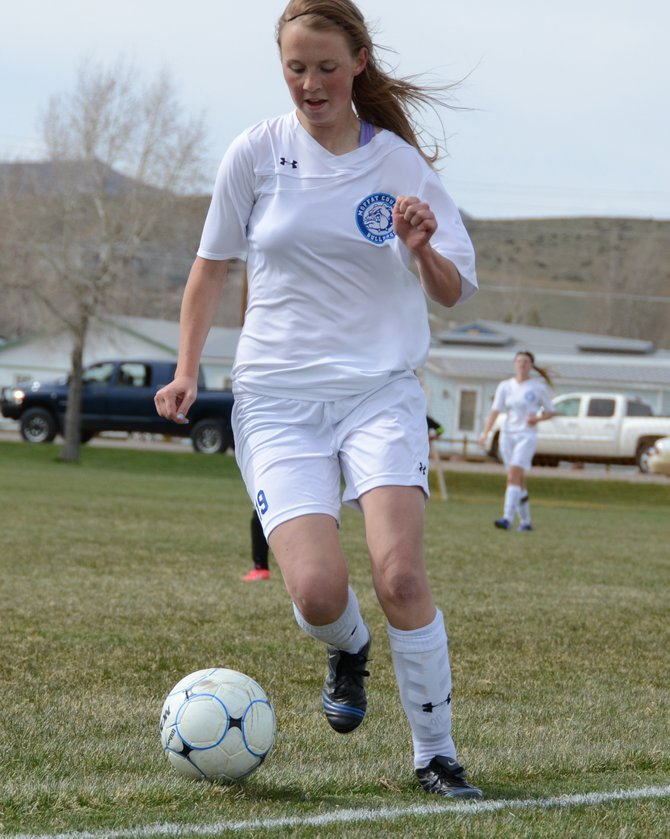 Moffat County senior Tori Snyder toes the sideline as she tries to keep the ball in play Monday at Woodbury Sports Complex. Snyder and the Bulldogs secured a 1-1 tie with Aspen to stay in front of the Skiers in the Western Slope League playoff standings.