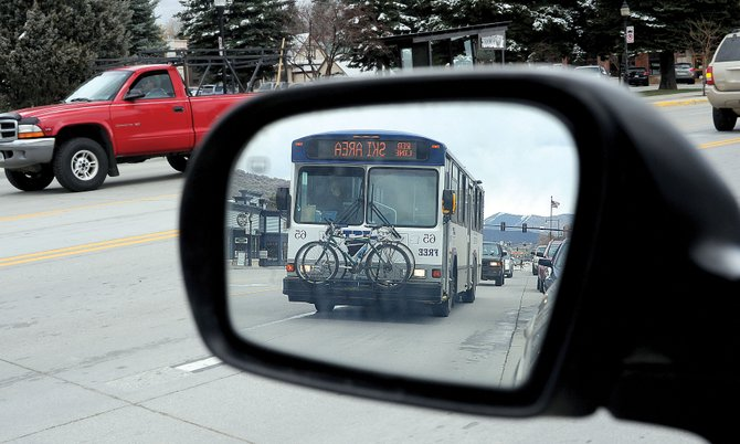 A bus moves along Lincoln Avenue in Steamboat Springs on Wednesday afternoon. Saved from budget cuts in autumn 2012, the Steamboat Springs Transit Yellow Line grew passenger numbers by 62 percent during the ski season.