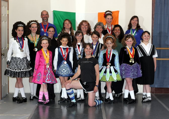 Members of the Bennett School of Irish Dance, including instructor Nora Parker, front, display medals they won at Feile Denver, an Irish dance competition April 14 and 15 in Loveland. Parker is leaving Steamboat in the summer.