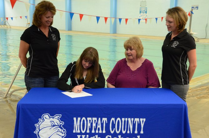 Eryn Leonard, second from left, signs her letter of intent to swim for Colorado Mesa University next year. The Moffat County High School senior was a state qualifier in two events this past season.