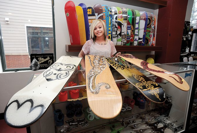Hayden artist Megan Swedberg displays a few of the skate decks she has painted for the fifth annual Skate Deck Artists Show at Urbane, which opens as part of First Friday Artwalk.