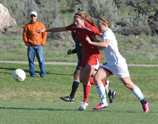Glenwood Springs High School's Lilly McSwain, left, is chased by Steamboat Springs' Suzanne Lyon during Thursday's match at Gates Soccer Park in Glenwood Springs. The Sailors won, 3-2.