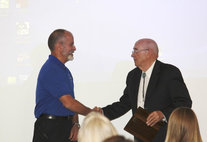 Western Colorado Peace Officers Association Awards Chairman Lynn Hood, right, presents the Lifetime Achievement Award to former Steamboat Springs Police Department Chief JD Hays on April 26 at the association's spring conference.
