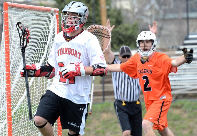 Steamboat Springs senior Dane Dixson jogs away after scoring a key goal — much to the goalie's dismay — late in Saturday's game against Grand Junction. The Sailors won, 11-9.