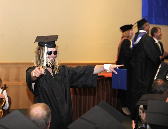 Kerry Lofy celebrates after receiving his Colorado Mountain College bachelor's degree diploma Saturday at The Steamboat Grand.