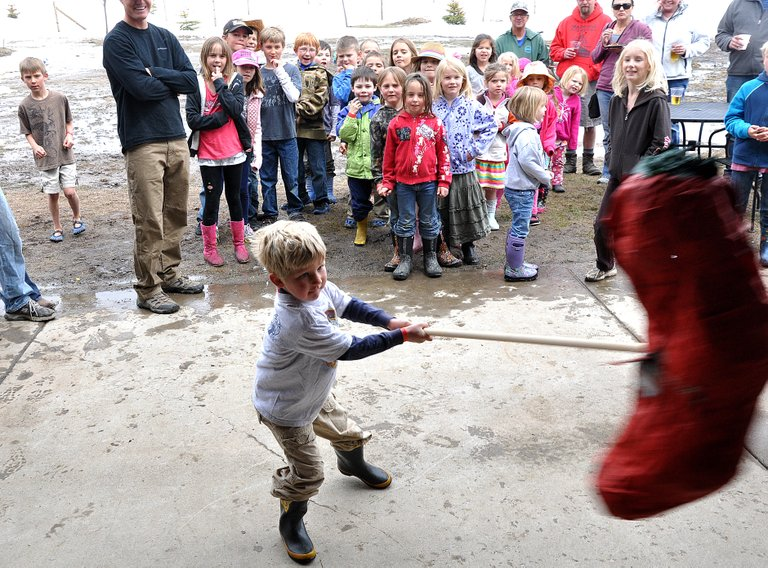 Colyer Lotz takes a swing Sunday at a giant chili piñata during the North Routt Chili Cookoff at the Hahn's Peak Roadhouse.