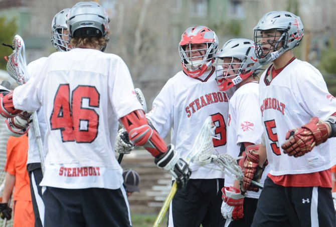 Steamboat Springs boys lacrosse players celebrate a win against Grand Junction on Saturday. The lacrosse squad will open what it hopes to be a lengthy postseason run at 5 p.m. Wednesday, playing at home against Windsor.