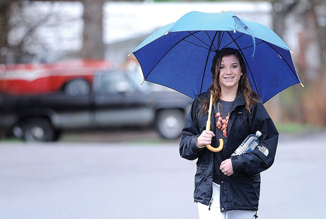 Tasha Getten uses an umbrella to shelter herself from the rain as she walks up 13th Street toward Colorado Mountain College on Tuesday morning.
