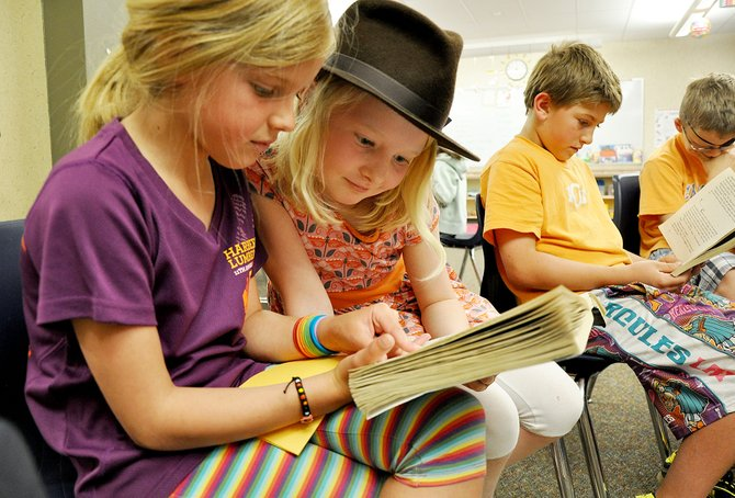 Third-graders Ellery Hodges, left, and Margaret Redfern read a book together Wednesday in Shannon Forbes' class at Soda Creek Elementary School. Third-graders in Steamboat Springs again scored well above the state average on their standardized reading test.