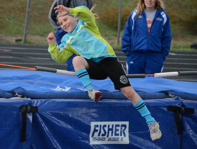 London Herring, a first-grader from Craig, goes over the bar at the high jump pit Wednesday at the Moffat County track. Herring was one of hundreds of young athletes to compete at the Moffat County Youth Track meet Wednesday evening.
